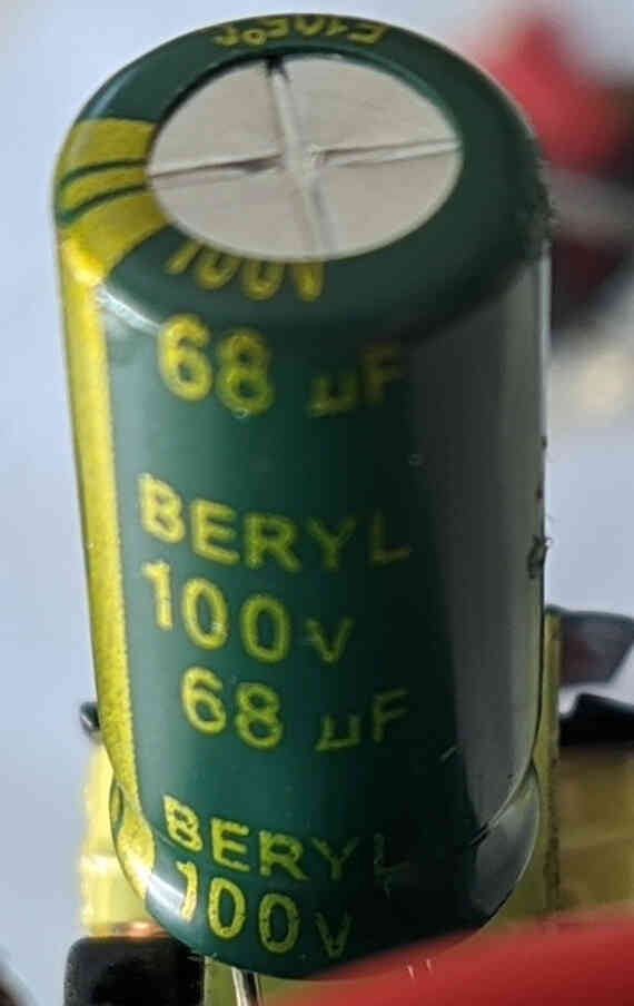The 100V, 68uF output filtering capacitor.